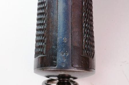 Marquages de ratelier sur la crosse d'un revolver 1874