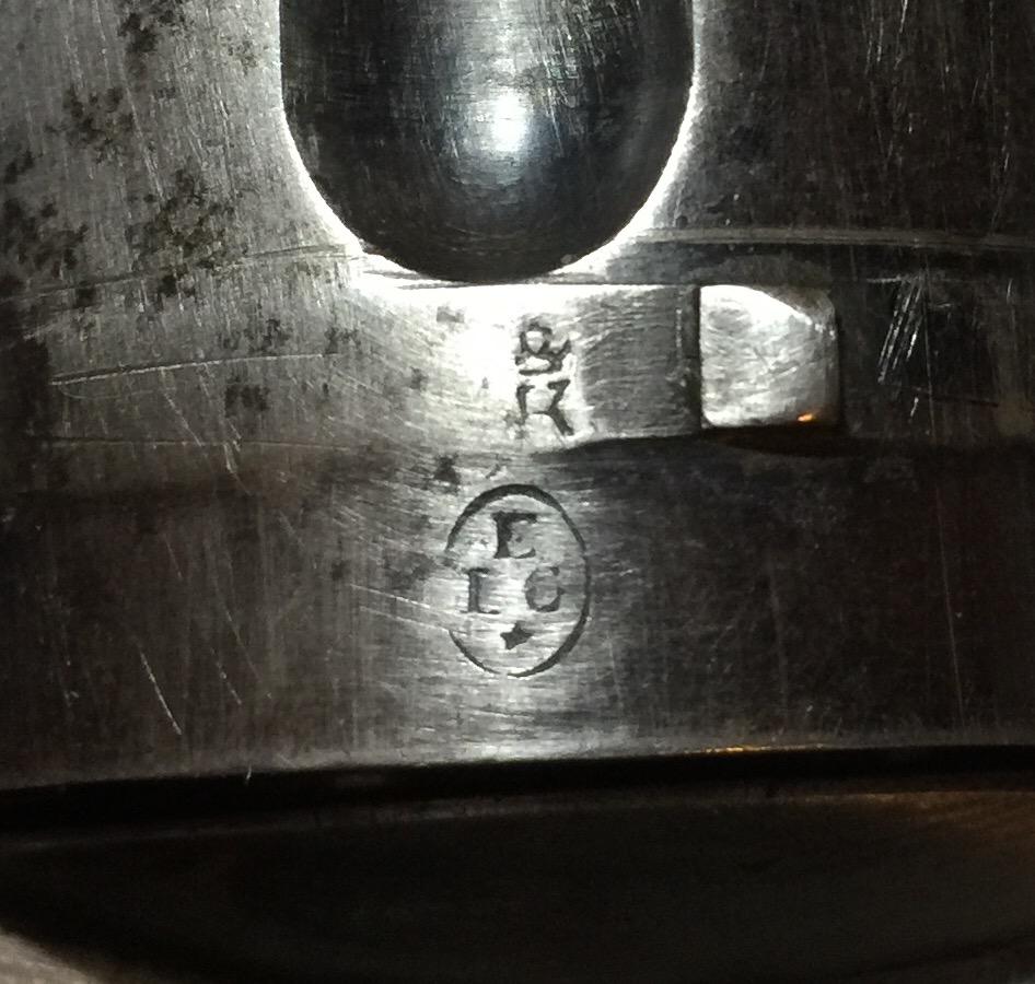 Poinçons belges ELG étoile dans un Ovale et K courronné du contrôleur