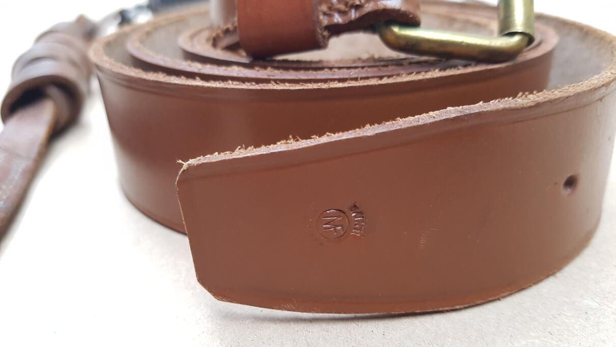 Logo Manufrance Saint Etienne sur courroie de ceinture pour l'étui jambon MF