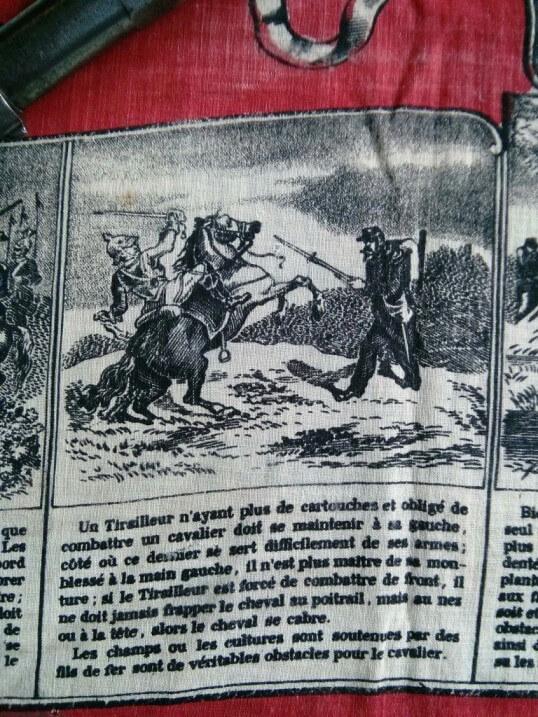détail d'un coin du mouchoir d'instruction numéro 1 sur le revolver 1873