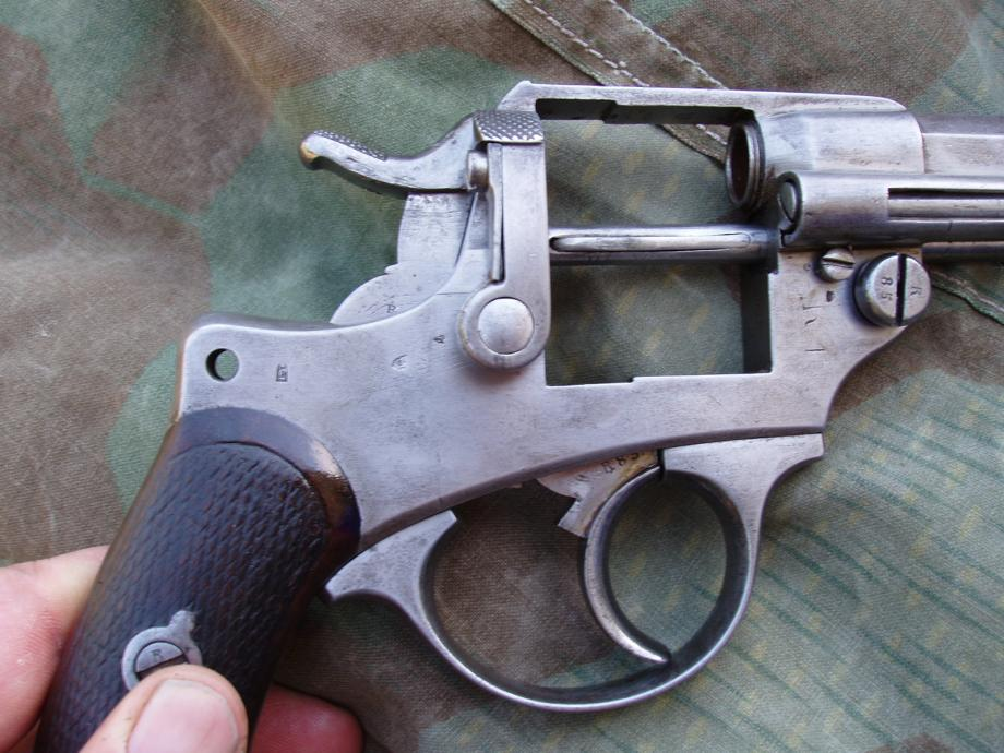 Revolver 1873 de la série X, marquages sur la carcasse