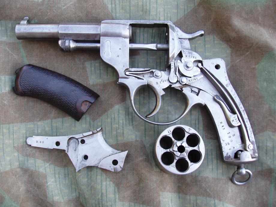 Revolver 1873 de la série X, détail du mécanisme et des marquages